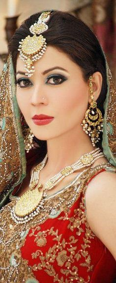 Indian Beauty.  Ilove the beautiful Indian silks and deep fabric dyes.