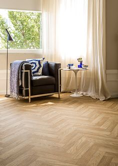 Cheaper than wood and easier to maintain than wood.  Have the parquet floor you have always dreamed of.  This is modern vinyl - http://www.floorcovering-edinburgh.com/vinyl-flooring/