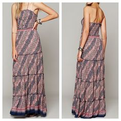 "FREE PEOPLE Dress Printed Smocked Maxi Tube Top Size XS. New without tags.  $128.  Color: Purple Combo.    Geometric patterned sleeveless maxi tube dress. Smocked upper bodice. Pleated Skirt portion is tiered. Semi - raw fringed seams.   - 100% rayon. - imported.  Measurements: Bust: 32"" Length: 48""   ❗️ Please - no trades, PP, holds, or Modeling.   ✔️ Reasonable offers considered when submitted using the blue ""offer"" button.    Bundle 2+ items for a 20% discount!    Stop by my closet for…"