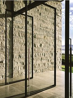 steel doors. jagged stones. sleek floor. (Aidlin Darling Design)