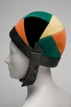 Woman's Helmet Hat Designed by Yves Saint Laurent, French (born Algeria), 1936 - 2008. Sold by Tribout Shop, John Wanamaker, Philadelphia. Made in France, Europe Date: c. 1965 Medium: Green, yellow, orange and black wool felt; black leather