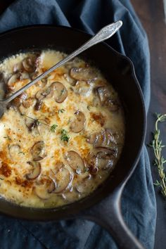 This decadent Baked Mushrooms and Fontina Dip recipe is a super easy crowd pleaser! Made with white wine and some fresh thyme, this cheesy dip has amazing flavor!   @tasteLUVnourish