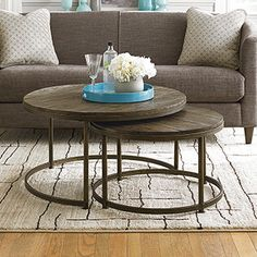 Features: -Round shape. -Weathered barn finish, antique brass. -Material: Tongue and groove solid plank, metal. -Smaller table nests under larger table. -Care and Cleaning / Care of finish: Dust