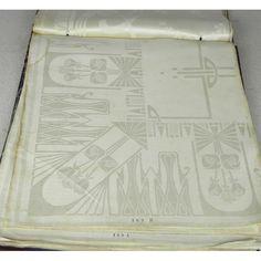 Stalenboek met donkerrood kaft en in wit het opschrift 'Tafelgoederen van Prima Linnen Damast (handwerk- Natuurbleek')....