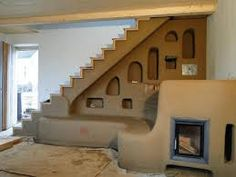 Cob stairs and. is that a potential rocket mass heater I see? Cob House Interior, Home Interior Design, Interior Modern, House Interiors, Cob Building, Building A House, Green Building, Adobe Haus, Rocket Mass Heater