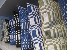 Graphic Textiles by Johanna Gullichsen - Those blue pillows would be fantastic in my living room.