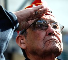 Frank G. Willetto, an 84-year-old Navajo code talker, renders honors  during the playing of the national anthem at a ceremony commemorating  the 65th anniversary of the Battle of Iwo Jima at the National Museum of  the Marine Corps in Triangle, Va., Feb. 19, 2010.