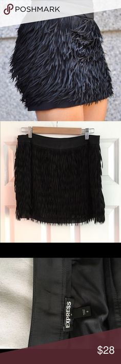 Express fringe mini skirt size 8 Express fringe mini skirt! Wore this once to a concert. No flaws, looks amazing on! Such a fun and flirty skirt! Express Skirts Mini