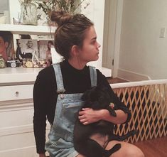 Maia Mitchell. Short overalls and black sweater