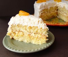 Mansarin Orange Cake with Pineapple frosting-I have an easy, light and flavorful cake recipe for you today. It's made with a mix, which I know many of you love. The ingredients are few and easy to find. Another bonus. The taste makes you think of sunny summer weather. The frosting is light, fluffy and refreshing. The cake is moist with a hint of orange.