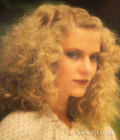 1979 blonde volume hairstyle    Long blonde hair was permed and brushed through for softness and the front softly twisted and pinned off the face     Hairstyle by: Julie Masterman