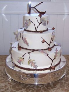 wedding cake with branches and leaves