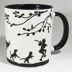 Follow my Leader Silhouette Design Ceramic Mug with glazed black handle and inner. Featuring a chicken, cow, goat, dog and cat on their hind legs following their esteemed leader Designed and printed in Britain. A high quality ceramic mug which is dishwasher proof. Height is 9.5cm, diameter 8.2cm, with a capacity of 310 ml (11oz). From the Series 1 Original Line from Half a Donkey www.halfadonkey.co.uk