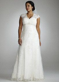 Romantic and feminine, this A-line gown mixes subtle drama with timeless elegance.   Empire waist is adorned with intricate beaded detail.  Cap sleeves add coverage while illusion lace back adds allure.  Gorgeous lace over satin fabric flows to shape a flattering A-line silhouette.  Chapel train. Available for Special order in Ivory or White.  Also available in Petite sizes 0P-16P, Style 7T3299,  (special order only), and Missy sizes,0-16 asStyle T3299,   Fully lined. Back zip. Imported…