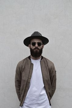 Layering with white tee, wide brim hat, beard, cool glasses, mens fashion, the tee project.  The hat tho