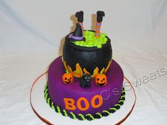 - bottom tier is pumpkin cake with cream cheese icing filling and caldron is white cake with peanut butter cup buttercream filling. all decorations are fondant