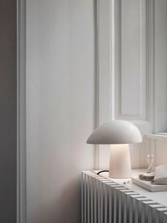 The Fritz Hansen Night Owl Table Lamp is a magical and beautiful lamp with an asymmetrical oval shade and conical base. Available in 2 finishes with an aluminium or ash wood base. Helsinki Design, Berlin Design, Fritz Hansen, Living Tv, Living Room, Ikea 2015, Luminaire Vintage, Design Apartment, Radiator Cover