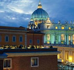 The Vatican at sunset -- what beautiful colors! Photo courtesy of Fra i vicoli di Roma.