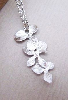 Beautiful Orchid Trio . Matte silver plated