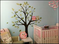 Make a very large simple tree (use vinyl or paint it by using a projector) and make it a family tree (add the family names) then add an owl for each person in your family.