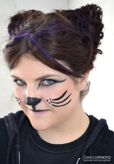 Cat face painting for Halloween.