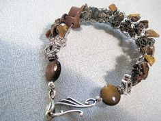 Items similar to Knit crochet wire bracelet cuff in -silver and healing gemstone- brown tiger eye chips - Wire wrap cuff bracelet under 40 usd on Etsy Wire Jewelry, Silver Jewelry, Tiger Eye Jewelry, Silver Cuff, Mothers, Knit Crochet, Cuff Bracelets, Corner, Chips