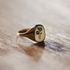 Poppy classic signet ring cast from an original hand engraved piece. Modern signet ring cast from recycled metal. Simple and minimal yet substantial. This is a classic ring that could easily become an heirloom. Made by hand and made to order in the USA, please allow up to 1-3 weeks to