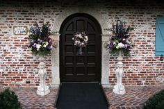 Wedding Ceremony in the front of the Historic Casa Feliz Museum Home.  Floral designs by Lana with Fairbanks Florist.  Art Faulkner Photographer.