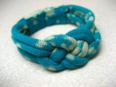 THIS OLD DRESS: Recycled T Shirt Knotted Bracelet Video tutorial (she paints her fabric first, so skip to the 6 minute mark for the Josephine knot itself. Could also make a headband with this knot.