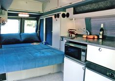 Sportsmobile Custom Camper Vans - RB-50 Contempo Fixed Top