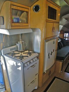 Vintage trailer kitchen.  All I need is my red checkered shirt, denim clam diggers, ballerina flats and my two blonde kids, Dick and Jane!