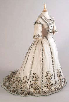 Dress: ca. 1863-1867, cotton gauze embroidered with beetle wings, thread and lace (embroidered in India for export). KSUM 1983.001.0098