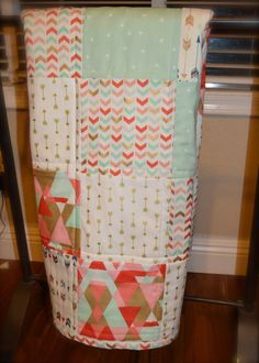 This adorable arrow themed patchwork quilt would be a perfect addition to any nursery or by itself as a gift! With a beautiful color