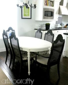 Painted white table and black chairs.