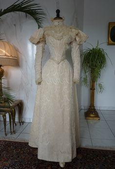 """Silk Brocade Wedding Dress, ca. 1895 // Two piece wedding dress, ca. 1895. Label: """"J. Jay Joslin & Son, Denver, Colorado"""". The dress is made of swirl patterned ivory silk. High neck bodice, capped long sleeves, ruched chiffon, pearl and crystal trims, trained skirt. Excellent condition."""