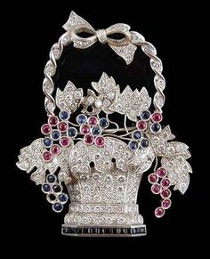 Platinum Diamond/Ruby/Sapphire/Onyx Basket Brooch.