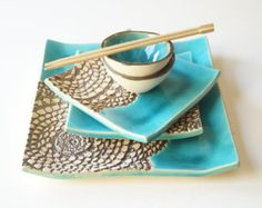An original art set for sushi service - This listing is for a 5 pieces ceramic service set that includes one big plate, two small plates and two soy sauce bowls.  This is a fantastic wedding or holiday gift for someone special who enjoys food. This set has been formed from white clay and covered gray and turquoise glaze. Gold bronze lace decor.  Size approx: Big plate 12 x 7 2 small plates 4.5 x 7 Soy dishes (bowls) 3 by diameter   Please do not hesitate to contact me with any questions or…