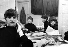 The Beatles backstage for a 1963 Christmas concert
