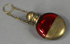 "Victorian ,cranberry glass Perfume bottle supported by chatelaine chain. Sampson Mordan & Co., London, Hallmark above engraved ""M. Greenway"" on metal mount Perfume Parfum, Perfume Versace, Cranberry Vinaigrette, Perfume Calvin Klein, Bottle Jewelry, Fragrance Lotion, Cranberry Glass, Antique Perfume Bottles, Sculptures"