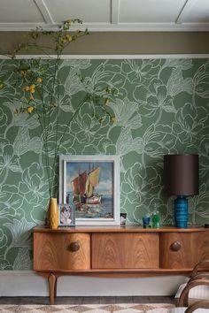 Amazing deep green wallpaper design called Helleborous.