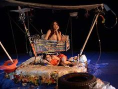 The Orchid Flotilla. (Magical Realism through Gestural Theater & Shadow Puppetry). Glass Half Full @ Salvage Vanguard Theatre, Austin, Texas. Conceived by Caroline Reck, performed by Caroline Reck and Gricelda Silva. Saturday, September 20, 2014.