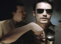 """Mike Patton with Billy Gould in background. Faith No More's """"Evidence"""" video. 1995."""