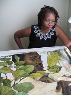 Ruth Miller, artist, with her hand embroidered piece. Fantastic!