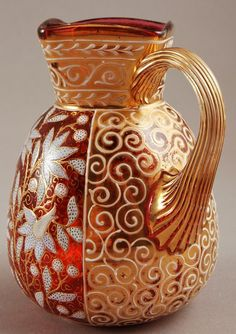 Three pieces of hand painted enameled Moser glass, includes a bowl, jar, and cranberry pitcher.