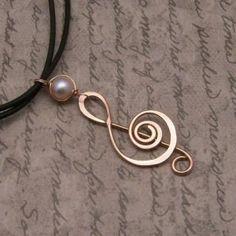 treble clef wire pendant.  Make a guitar too