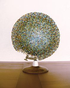 Pins on a globe.  I would like to know what the material of the globe is. Mine would probably be too hard & cause the pins to bend.