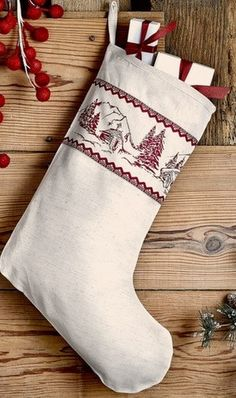 "Cabin Christmas Stocking 11x15"" Put the finishing touches on your decorating with this Cabin Christmas stocking. This stocking measures 11x15"" and features a border of red stenciled mountains, a cabin"