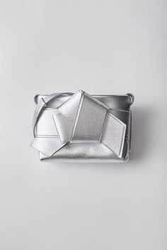 Acne Studios Musubi Handbag silver is a functional bag based on the knot in a traditional Japanese obi sash.