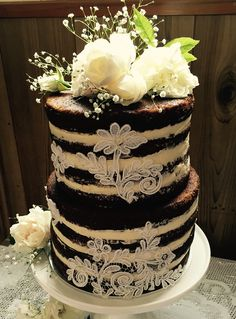 Naked carrot cake with fresh flowers & lace