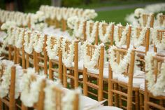 Leis on every chair for a destination wedding in Hawaii
